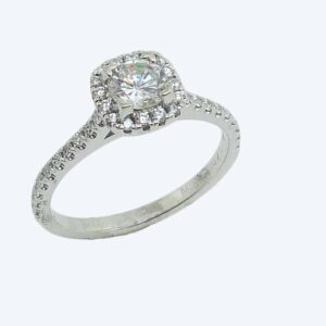 19K white cushion-shaped halo engagement ring accented by 0.36cttw G/H, VS-SI, round brilliant cut diamonds.