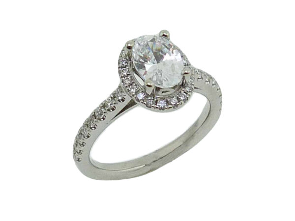 18 karat white oval halo engagement ring accented by 36 = 0.75cttw G/H, VS-SI, round brilliant cut diamonds. Priced without a center gemstone. Let us find you the perfect center that fits your tastes and budget!