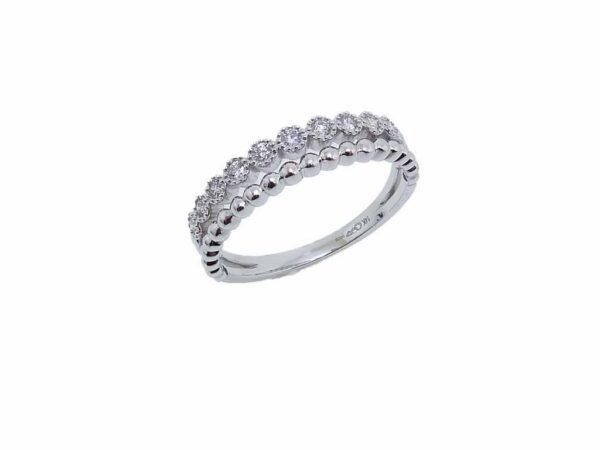14K white gold stacking illusion band set with 0.15cttw G/H, VS-SI, round brilliant cut diamonds.