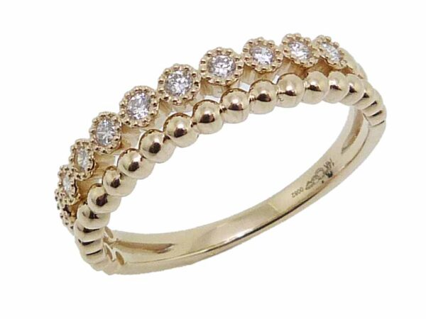 14K yellow gold stacking illusion band set with 0.15cttw G/H, VS-SI, round brilliant cut diamonds.