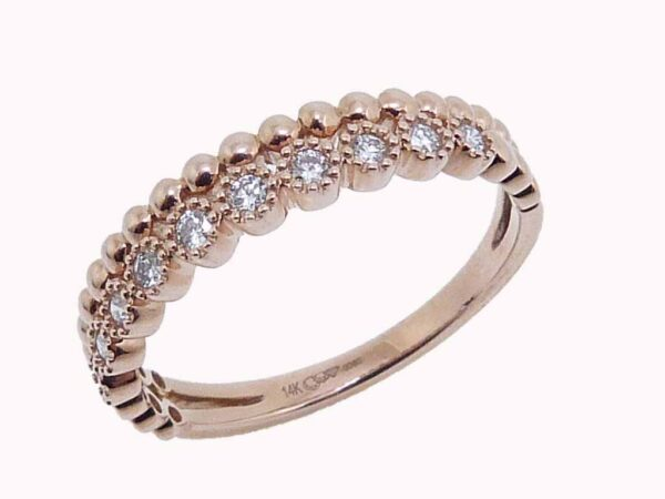 14K rose gold stacking illusion band set with 0.15cttw G/H, VS-SI, round brilliant cut diamonds.