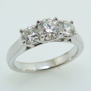 14K White gold custom 3 stone engagement ring claw set with 0.510ct J, VS2 and accented on each side with 0.26ct J, VS2 and 0.265ct I, SI1.