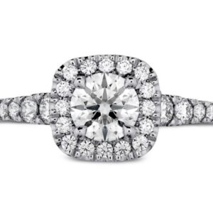 18kw Transcend engagement ring by Hearts On Fire set with one 0.506ct I, VS2 ideal cut, round brilliant cut Hearts On Fire diamond and accented on the halo and sides with 0.44cttw, G/H, VS-SI round brilliant cut diamonds.