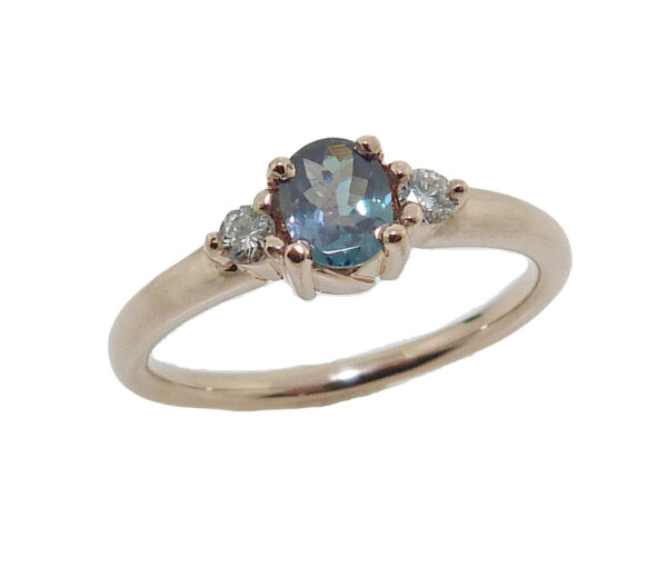 14 karat rose gold ring set with a 0.35ct Alexandrite and accented with 2 = 0.083cttw H, SI1-2, very good cut, round brilliant cut diamonds. Alexandrite is the birthstone for June.