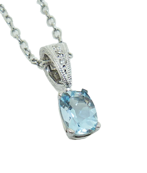 14 white gold pendant set with a 0.78ct aquamarine and accented with a 3 = 0.04ct H/I, SI round brilliant cut diamonds. Aquamarine is the birthstone for March.