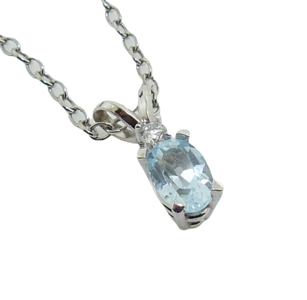 14 white gold pendant set with a 0.40ct aquamarine and accented with a 0.03ct round brilliant cut diamond. Aquamarine is the birthstone for March.