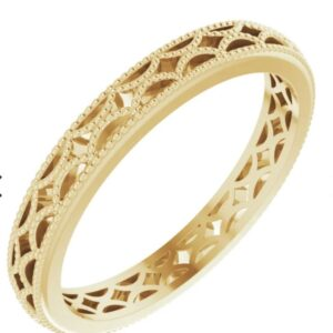 Lady's 14K yellow gold patterned design band, 3 mm width, size 7.