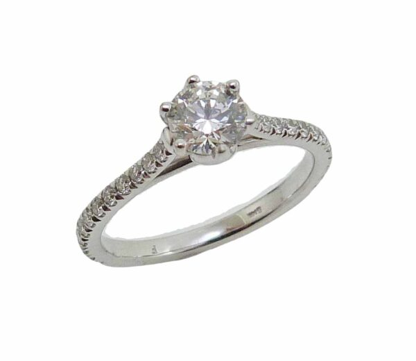 14K White gold 6 prong engagement ring claw set with 0.502 carat, I, SI2 ideal cut, round brilliant cut diamond by Hearts On Fire in the centre and accented on the band with 24 french-set round brilliant cut diamonds totaling 0.33 carat.