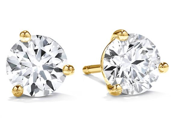 18K yellow gold three prong stud diamond earrings set with two I-J, VS-SI ideal, round brilliant cut diamonds by Hearts On Fire, totalling 0.38 carats.