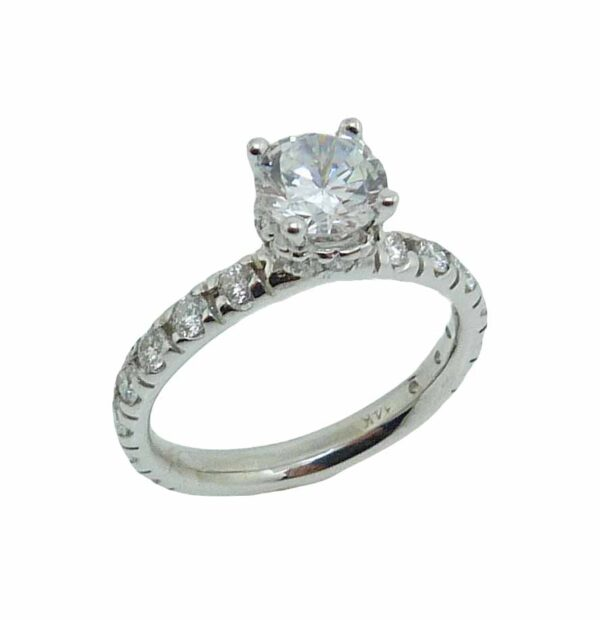 14K white gold solitaire engagement ring mounting with a hidden halo. This ring mounting is set with 26 = 0.556cttw Ideal cut, F/G, SI1 round brilliant cut diamonds.