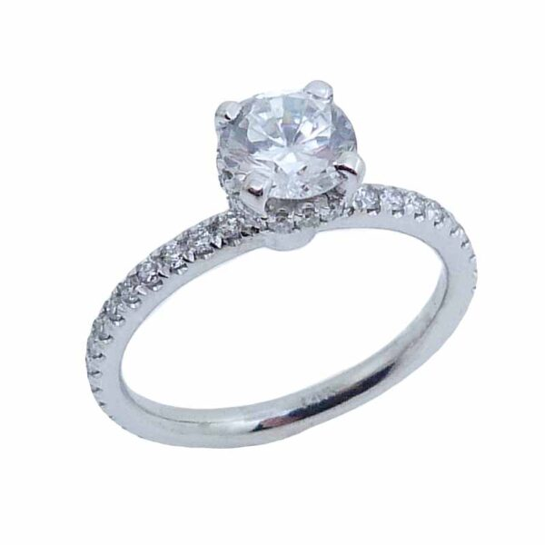 14K white gold solitaire engagement ring mounting with a hidden halo. This ring mounting is set with 58 = 0.46cttw G/H, SI1 round brilliant cut diamonds.