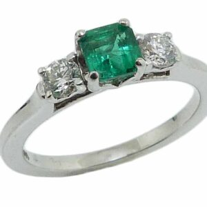 14K white gold ring set with a 0.47ct Asscher cut Emerald and accented with 2 ideal cut, I/J, SI2 round brilliant cut diamonds, 0.289cttw.