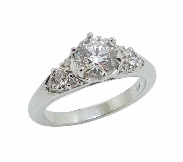 """14K White gold """"Queen Elizabeth"""" style engagement ring set with an ideal cut Hearts On Fire diamond, 0.752 carat, F, VS2 and accented on the sides with 8 excellent cut, round brilliant cut diamonds, 0.25cttw, F/G, SI1."""
