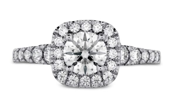 18K White Transcend Premier Custom Halo by Hearts On Fire set with one ideal, round brilliant cut Hearts On Fire diamond, 0.512 carat H, VS2 and accented on the halo and band with 24 ideal, round brilliant cut Hearts On Fire diamonds, 0.479 total carat weight, G/H, VS-SI.