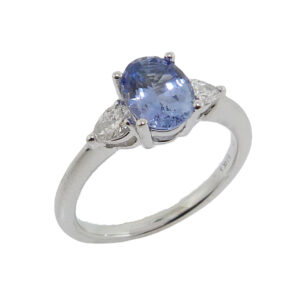 14K white gold ring set with 1.43ct Sapphire and 2 pear cut diamonds, 0.25cttw G/H, SI.