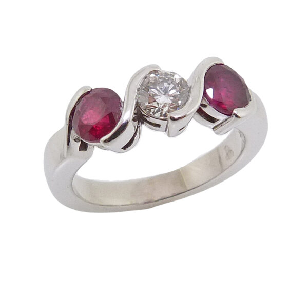 14K White gold lady's ring semi-bezel set with an excellent cut, round brilliant cut diamond, 0.30 carat E, SI1 , GIA and accented with 2 bezel set round rubies, 1.038 total carat weight.