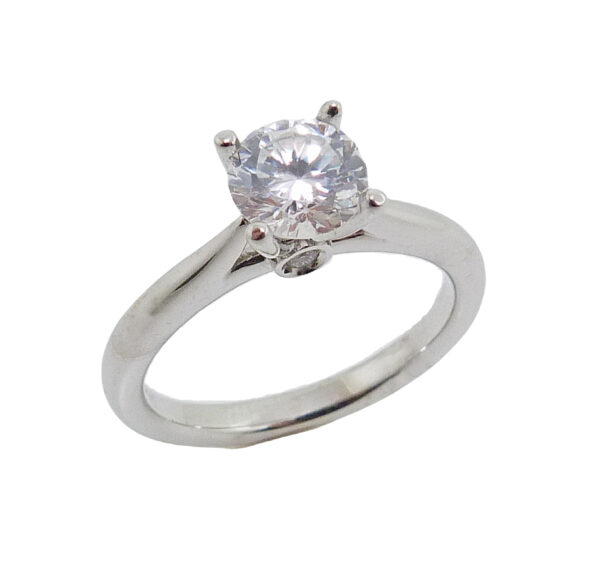 14K white gold solitaire mount claw set with a 0.75 carat CZ center accented on the profile with 2 bezel set round brilliant cut diamonds, 0.02-0.03cttw, I, VS. Priced without a center gemstone. Let us find you the perfect center that fits your tastes and budget!
