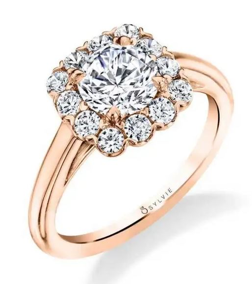 """14K Rose and white gold Sylvie Collection """"Chloe"""" Halo engagement ring set in the centre with a 0.5ct CZ and accented on the cushion shaped halo with 12 round brilliant cut diamonds totalling 0.30 carats, G/H, VS-SI. This ring has a matching wedding band. This ring is available with a round or cushion shaped halo and in 14 or 18K white, yellow and rose gold as well as platinum. Priced without a center gemstone. Let us find you the perfect center that fits your tastes and budget!"""