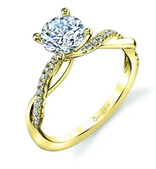 14K yellow and white gold solitaire Yasmine bypass engagement ring by Sylvie Collection featuring 0.14cttw G/H, VS-SI round brilliant cut diamonds.