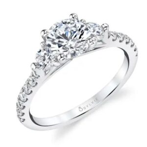 """14K White Sylvie Collection """"Tatianna"""" 3 stone engagement ring set in the centre with a 0.50ct CZ and accented with 0.62 total carat weight side diamonds, G/H, VS-SI. This ring has a matching wedding band. This unique ring is available in 14 or 18K white, yellow and rose gold as well as platinum. Priced without a center gemstone. Let us find you the perfect center that fits your tastes and budget!"""