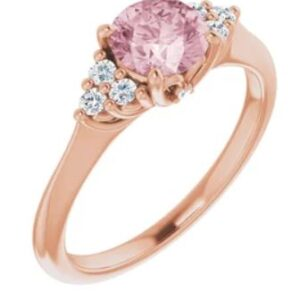 14K rose gold ring set with a 0.79ct round Morganite and 6 = 0.20cttw H, SI1-2, very good cut round brilliant cut diamonds.