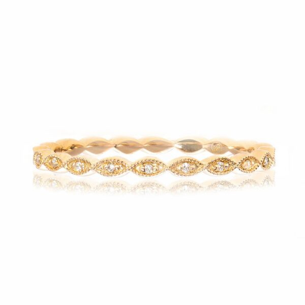 14K yellow gold band pave set with 11 = 0.03cttw G/H/I, VS-SI round brilliant cut diamonds.