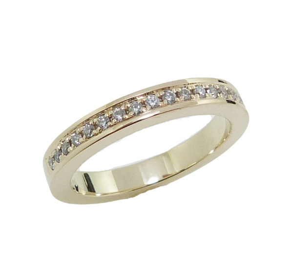 14K yellow gold band pave set with 17 = 0.133cttw G/H, SI1-2 round brilliant cut diamonds.