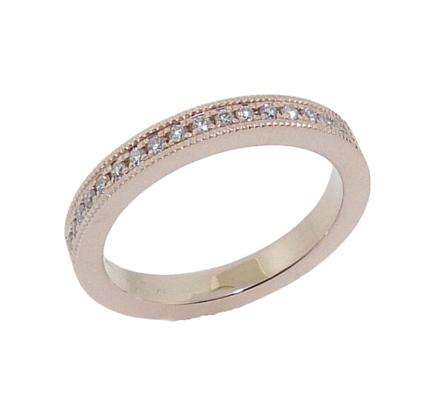 14K rose gold band pave set with 17 = 0.133cttw G/H, SI1-2 round brilliant cut diamonds.