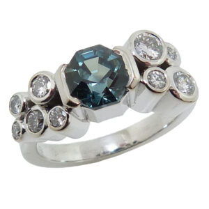 14K White gold Studio Tzela custom lady's ring semi bezel set with one 1.41 carat blue/green octagonal natural sapphire, GIA graded and 9 bezel set, very good-excellent, round brilliant cut diamonds, 0.47 total carat weight, F/G, VS1-2.