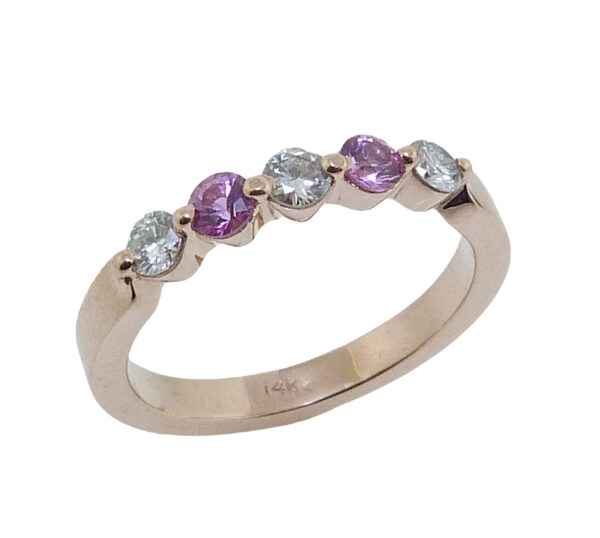 14 karat rose gold band claw set three round brilliant cut diamonds and two pink sapphires.