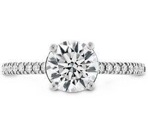 18K White gold Hearts on Fire Sloane Silhouette Diamond Solitaire by Hailey Page set with an 0.804 carat, G, VS2, ideal, Hearts On Fire diamond, 0.183 total carat weight round brilliant cut Hearts On Fire diamonds, G/H, VS-SI and 2 bezel set pink sapphires on the profile, 0.027 total carat weight.