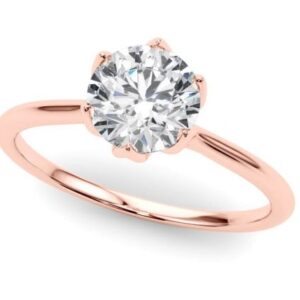 Six prong rose gold solitaire engagment ring.
