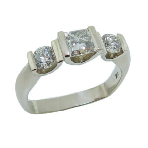 Lady's 14K white gold ring, bar-set with a 0.502 carat, J, SI2 CanadaMark princess cut diamond and on the sides are two, I-J, SI2, ideal round brilliant cut diamonds, totaling 0.373 carats.