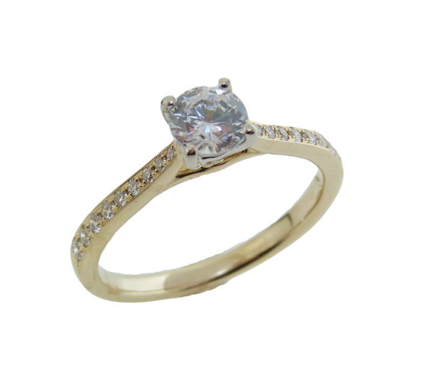 14K yellow and white gold solitaire engagement ring set with a 0.50ct cubic zirconia in the center and accented with 18 = 0.17cttw G/H, VS-SI round brilliant cut diamonds.