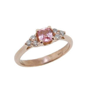 14K rose gold ring set with a 0.407ct Padparadscha sapphire and accented with 6 = 0.13cttw H, SI1-2 round brilliant cut diamonds.