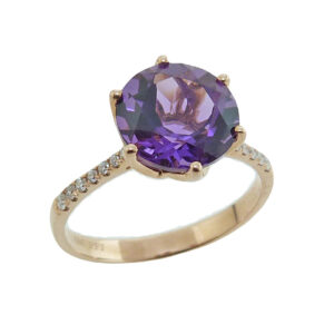 14K yellow ring set with 9mm amethyst and 0.11cttw, G/H, SI, round brilliant cut diamonds.