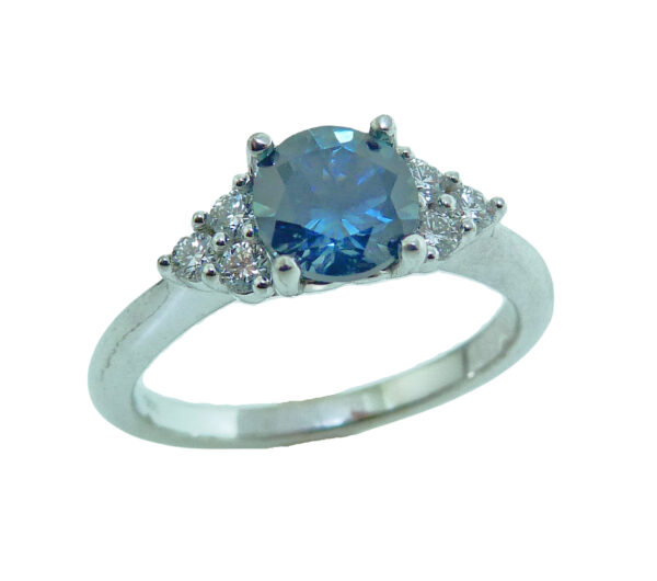 14 karat white gold ring featuring a 1.25ct round blue/green sapphire and accented with 6 = 0.17cttw of round brilliant cut diamonds.