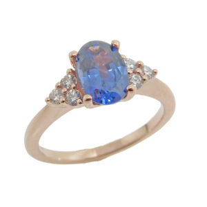 14K rose gold ring set with a 1.20ct oval blue Spinel and accented with 6 = 0.17cttw E/F, VS2-SI round brilliant cut diamonds.